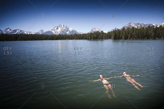 Two women relaxing in lake