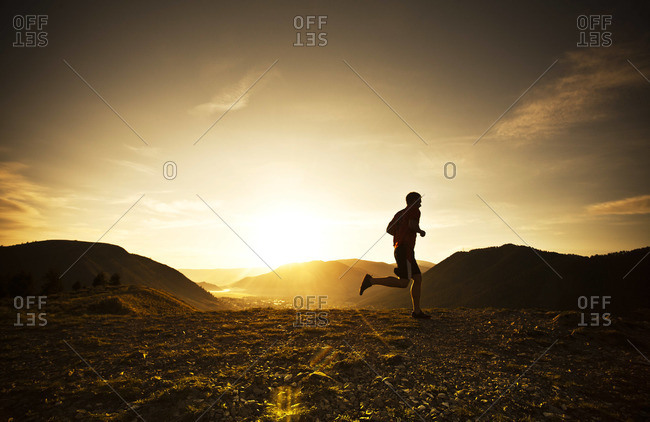 Silhouette of a man running in landscape