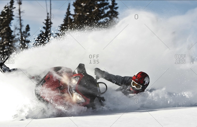Man riding snowmobile in forest