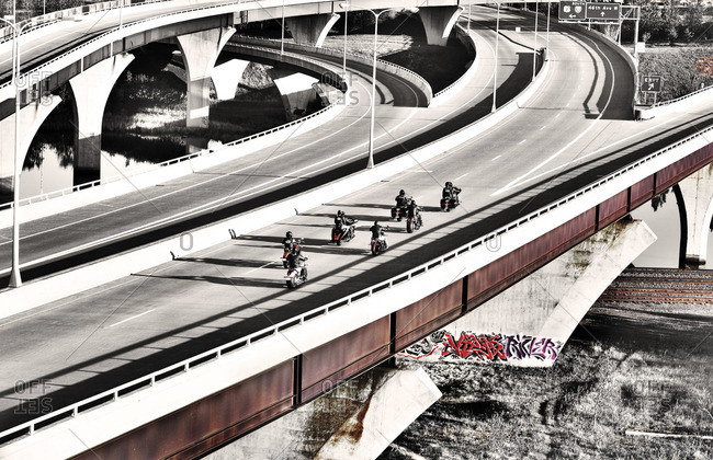 Group of motorcyclists riding along highway