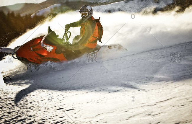 Man riding snowmobile in landscape