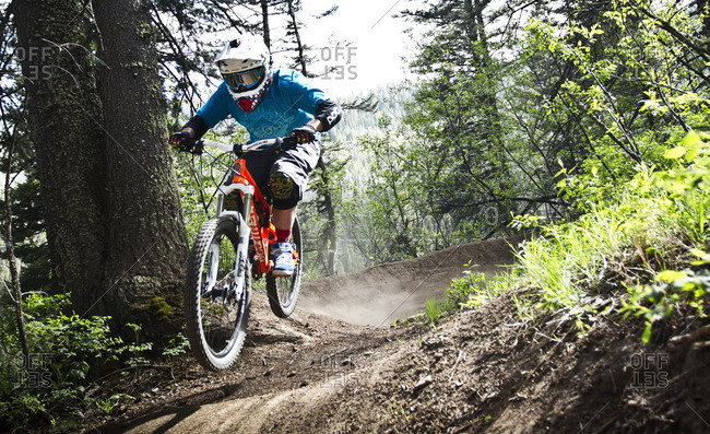 Man cycling on bicycle motocross in forest