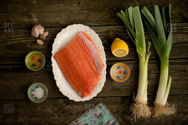 Ingredients for a salmon dish neatly laid out on a table