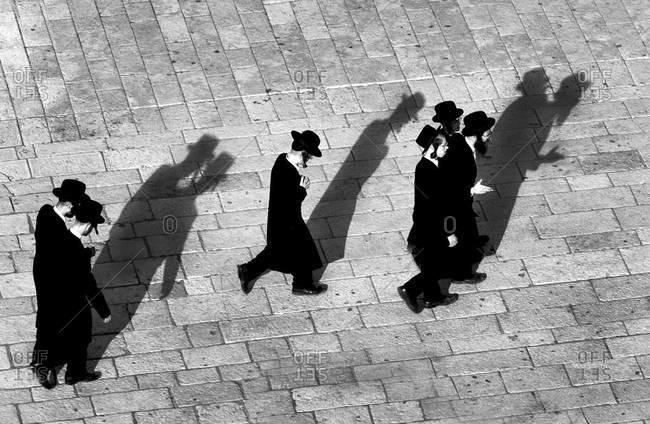 JERUSALEM -  JUNE 6, 2011: Orthodox Jews walk together after prayer
