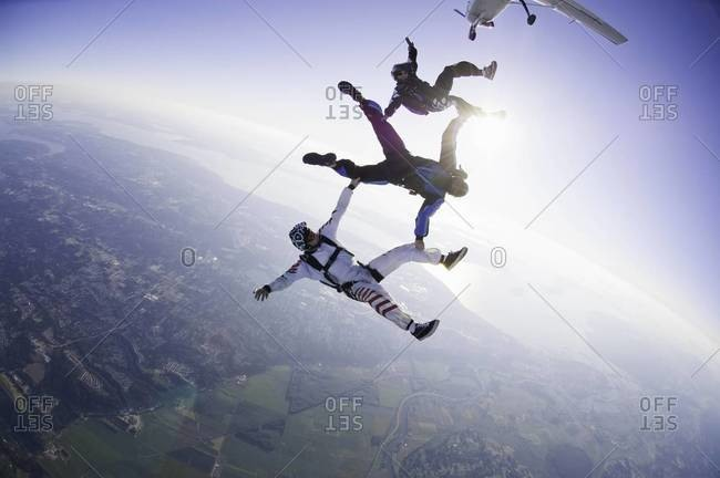 Three skydivers in freefell