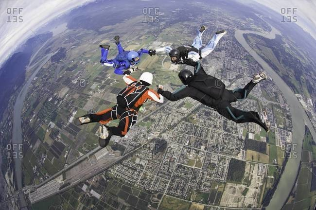 Four skydivers in circle formation