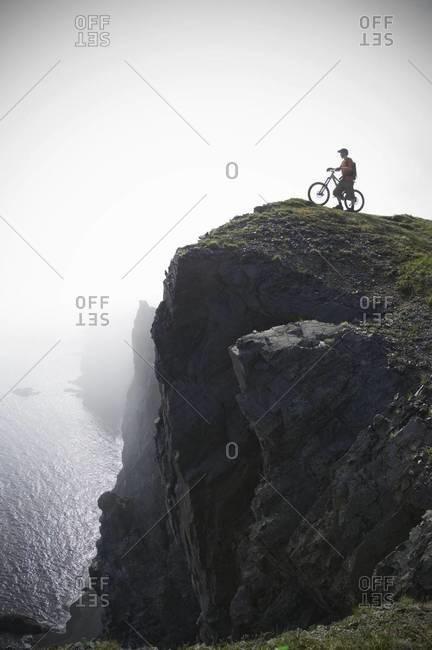 Mountain biker at edge of cliff