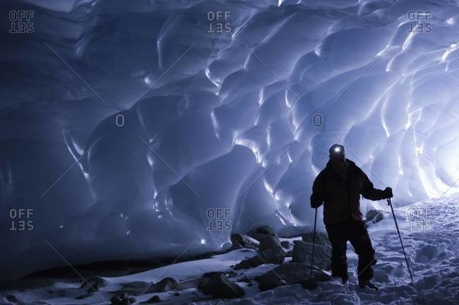 Man in ice covered cave