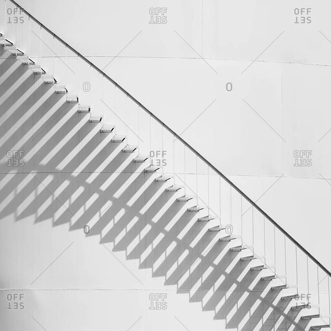 Steps leading up the side of a white storage tank at an oil refinery plant