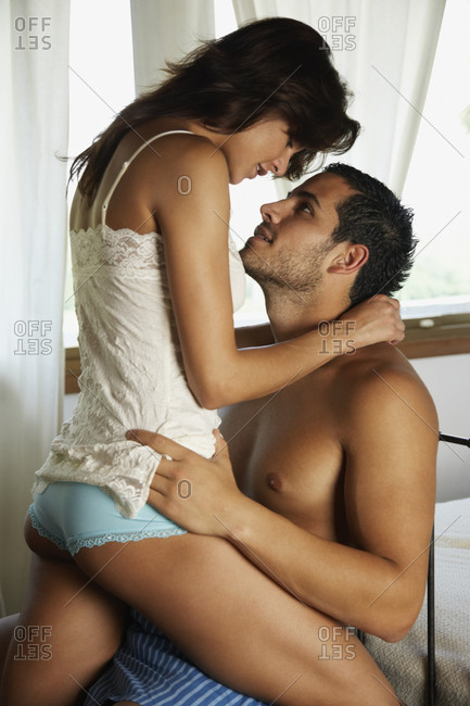 Woman straddling boyfriend