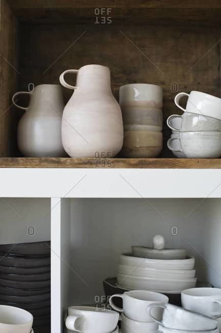 Ceramic kitchenware on shelf