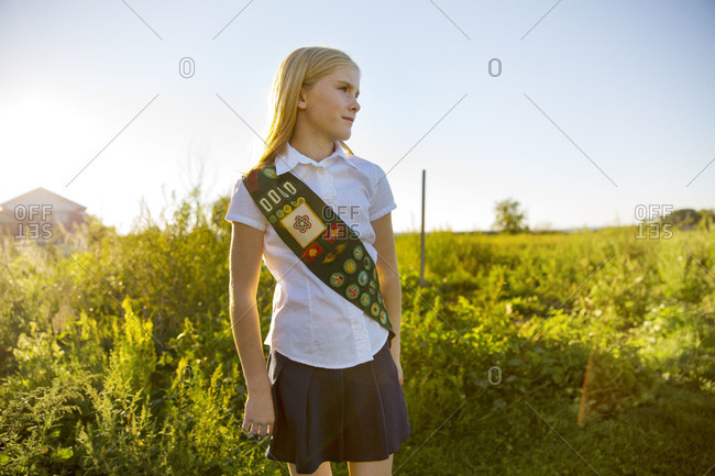 Girl scout standing in field