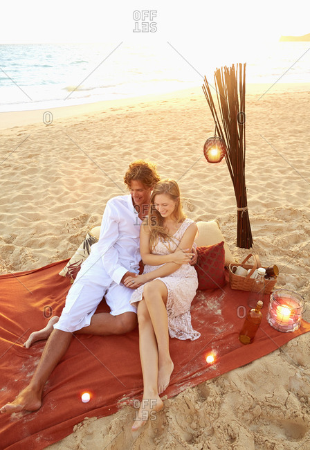 Couple relaxing on beach blanket