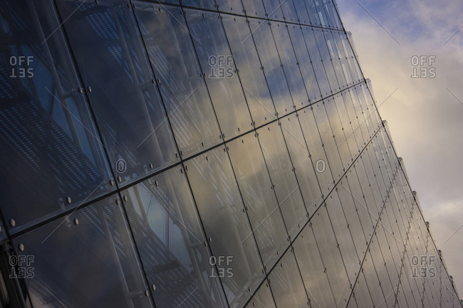 Close up of clouds reflected in windows of highrise