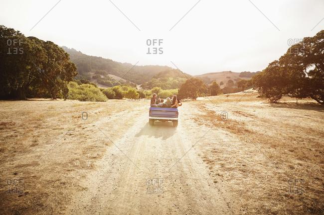 Friends driving in truck in rural landscape