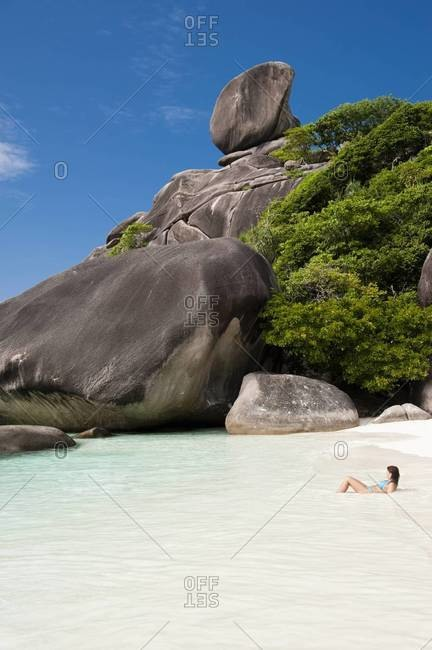 A woman relaxes in the water on Ao Kuerk beach on Ko Similan in the Similan Islands