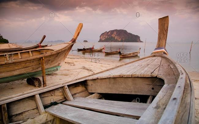 Longtail fishing boats on a beach of the island of Ko Yao Yai