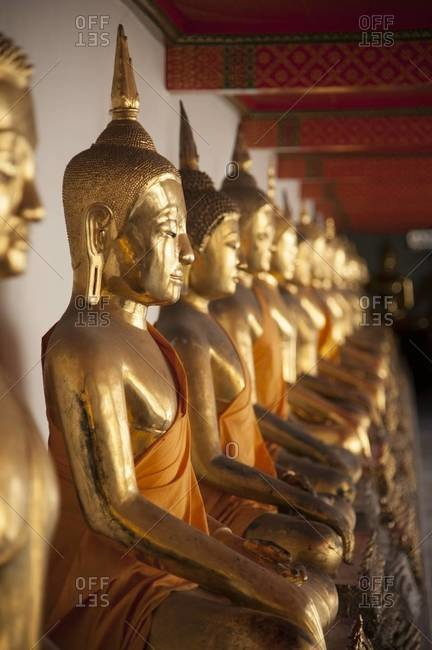 A row of Buddha statues at Wat Pho in Bangkok