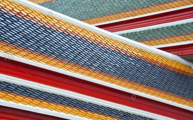 Colorful roof tiles of the  Wat Pho temple in Bangkok