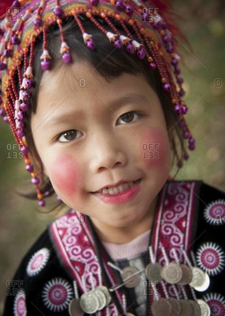 CHAING MAI, THAILAND - JANUARY 13, 2012: Portrait of a hill tribe minority girl at Wat Doi Suthep