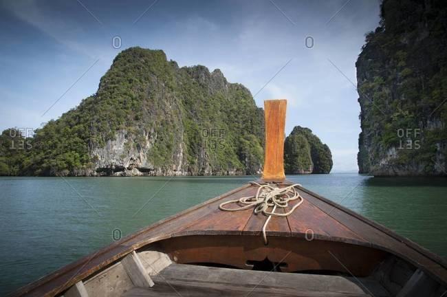 A longtail boat explores the small tropical islands near Ko Lanta