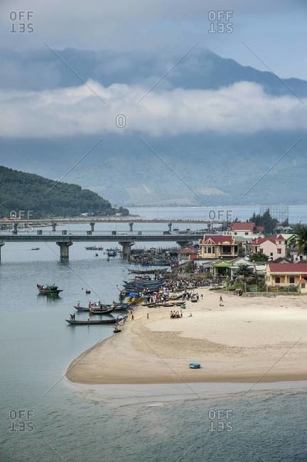 Boats enter the water in the beach town of Lang Co in Central Vietnam