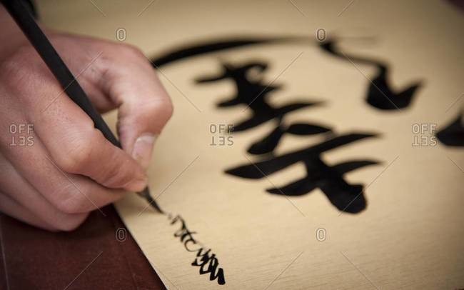 A calligraphy artist paints Tet posters outside the Temple of Literature in Hanoi