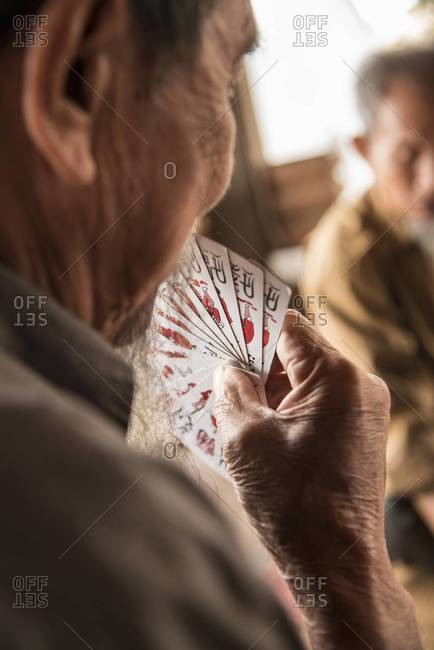 Elderly men playing to tom, a Vietnamese card game