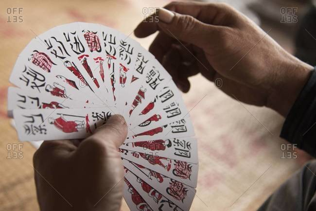 Man playing to tom, a Vietnamese card game