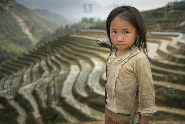 Cat Cat and Sapa, Vietnam - April 18,2013: Portrait of a girl at terraced rice fields