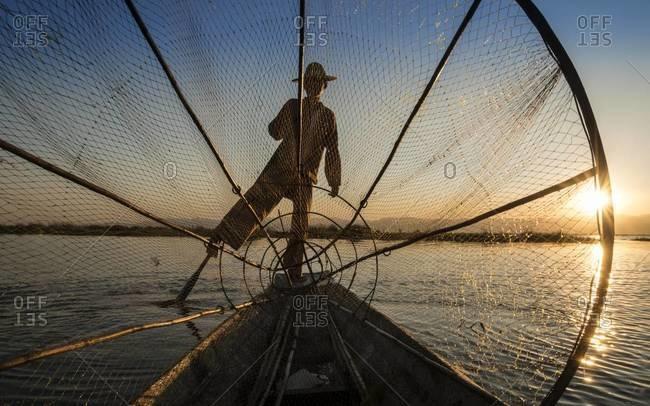 Outline of leg rowing fisherman on the Inle Lake, Myanmar