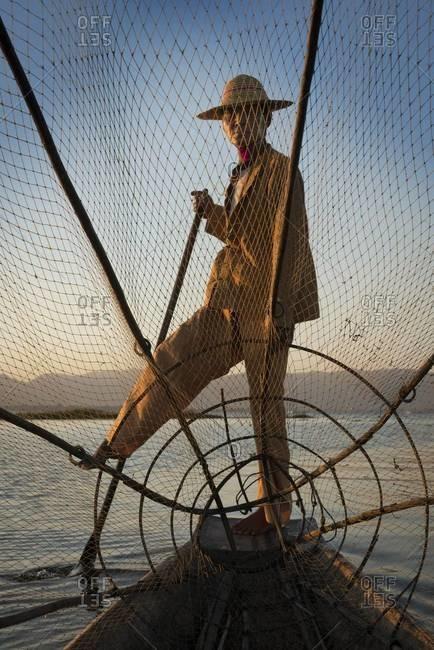Inle Lake, Myanmar - February 2,2014: Leg rowing fisherman on lake