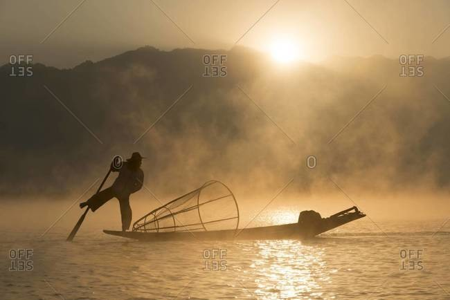 Stretched leg rowing fisherman on the Inle Lake, Myanmar