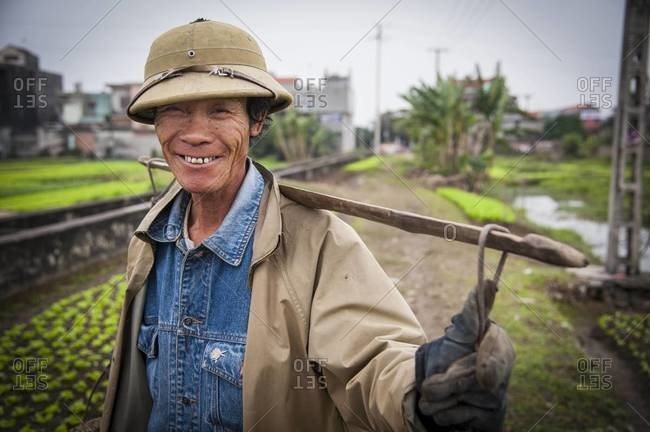 Vietnam - January 29,2012: Portrait of a Vietnamese rice field worker