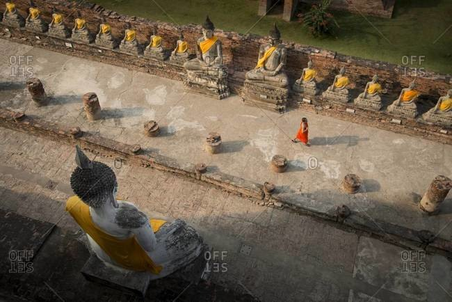 Wat Yai Chai Mongkhon, Ayutthaya, Thailand - January 16,2013: High angle view of a Buddhist monk walking at a temple