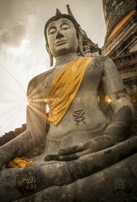Close up of a sitting Buddha statue at a temple in Ayutthaya, Thailand