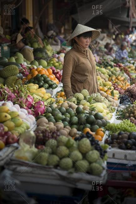 Vendor at a fruit market in Hanoi, Vietnam