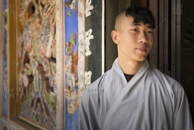 Hue, Vietnam - March 29,2013: Portrait of a young Buddhist man