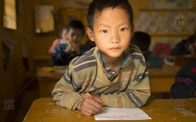 Sapa, Vietnam - April 1,2013: Portrait of a student in the classroom