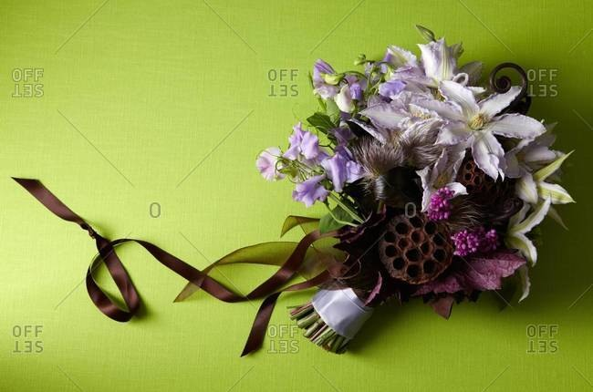 Purple bouquet on green background