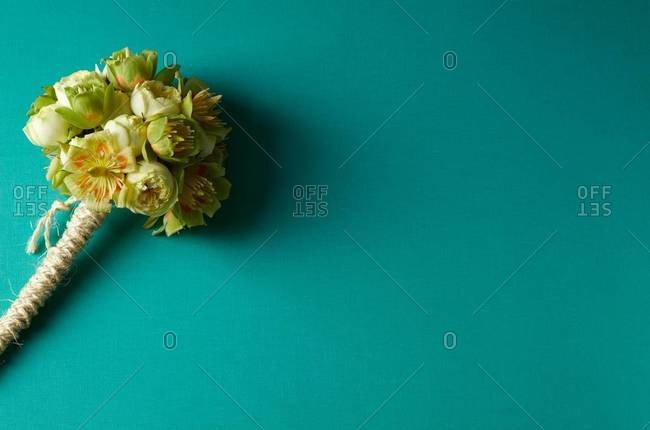 Yellow bouquet on turquoise background