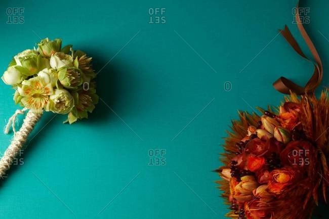 Yellow and red bouquets on turquoise background
