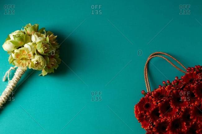 Yellow bouquet and a red handbag