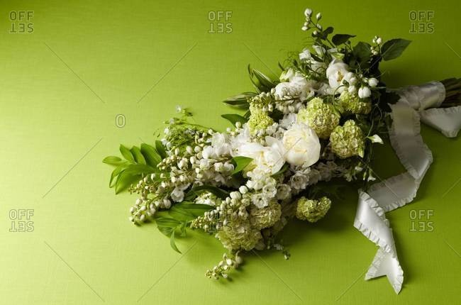 Bridal bouquet on green background