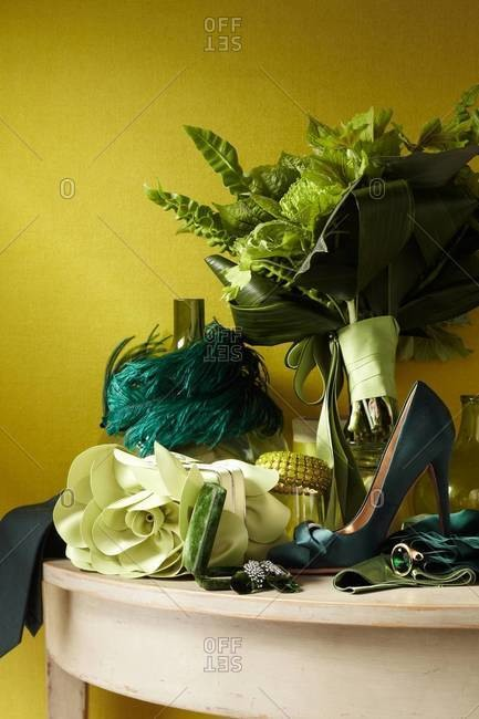 Fashion accessories and flowers arranged in interior