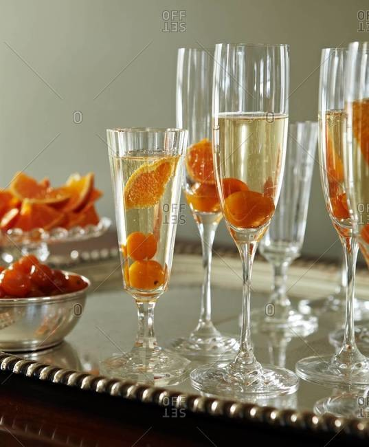 Sparkling wine served in elegant stemware with fruits