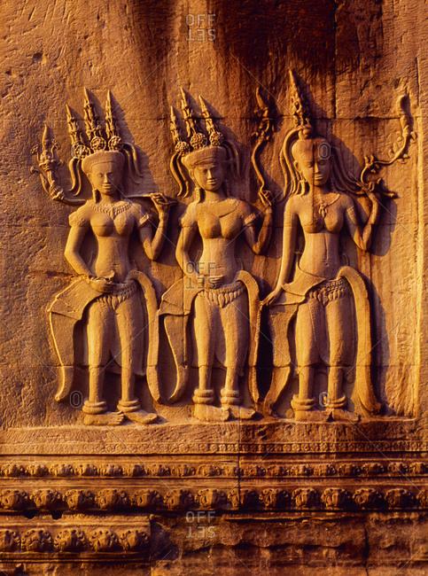 Devatas on bas relief of Angkor Wat