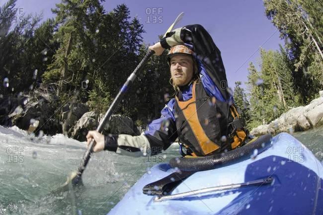 Man kayaking rough waters