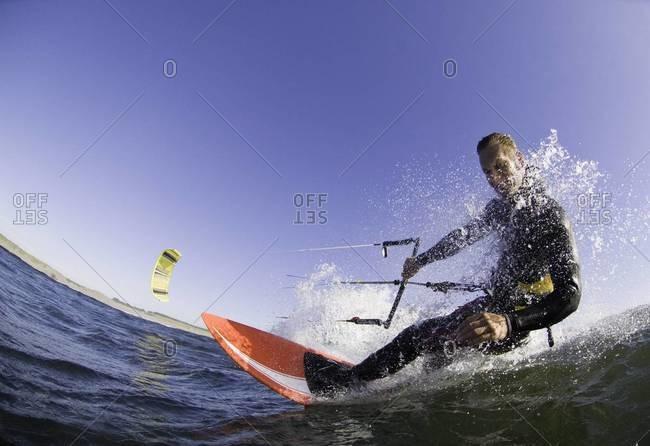 Man kite boarding