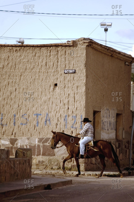 Detail of man riding a horse in an Argentinean village